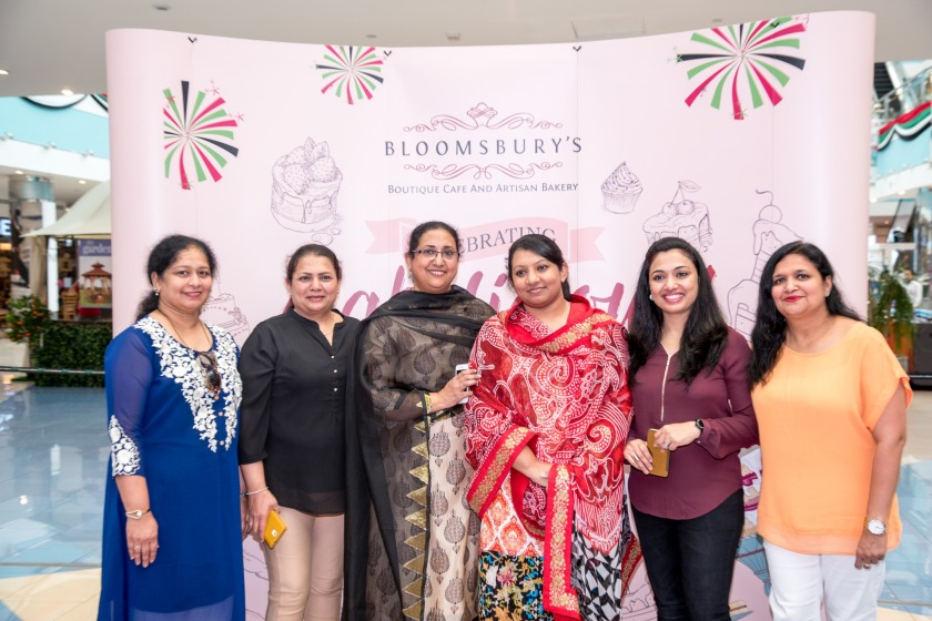 Shafeena Yousuf Ali ,CEO, Tablez Food Company with Ms. Nisha Thomas, Principal Special Care Center and Staff.jpg